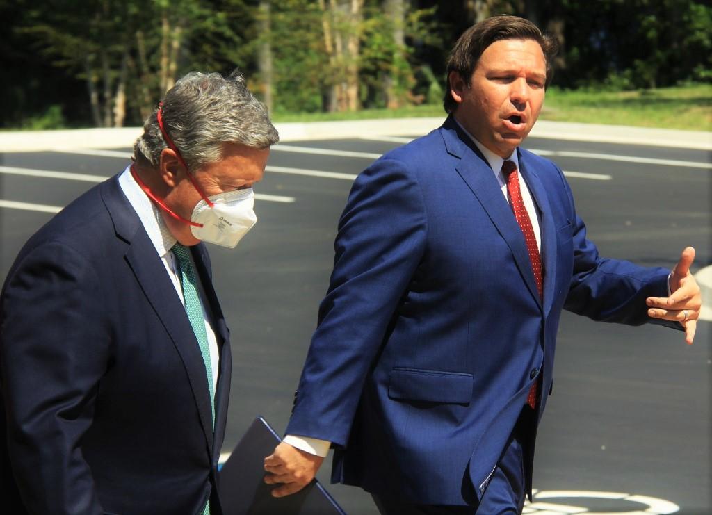 Gov. DeSantis talks with President Cost.