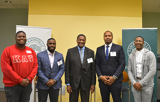Photo of Dr. Marvin Wells with members of the Black Alumni Network Panel