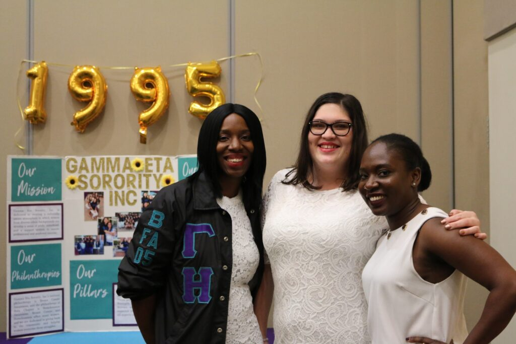 Photo of Gamma Eta Acting President Rebecca Knowles (middle) with two of her sorority sisters