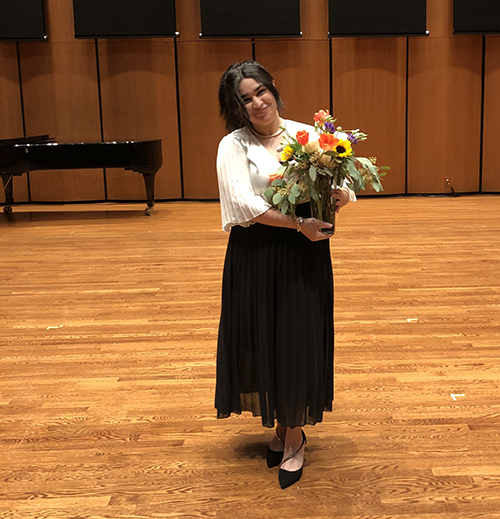 Photo of Jeilymar Morales holding a bouquet of flowers on award night