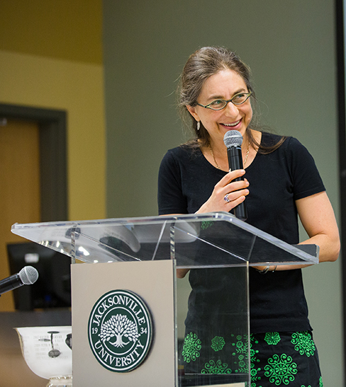 Photo of Dr. Nisse Goldberg at lecture podium