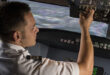 Article feature image of man in cockpit of plane