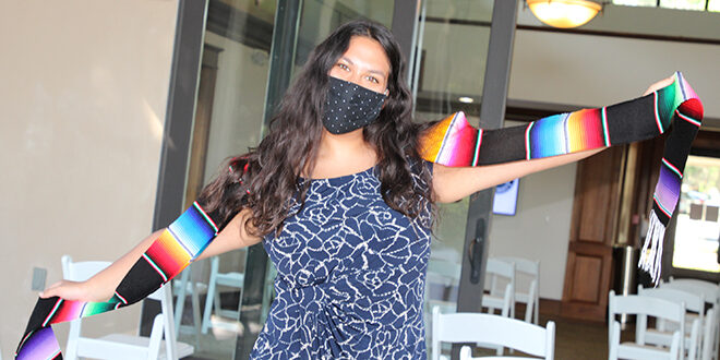Pamela Pacheco Aldana wearing the La Raza stole given to students who identify as Hispanic or Latino