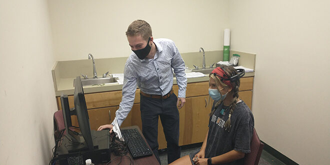 Two students working in the psych lab