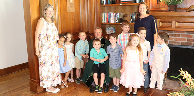 Wilma's Little People School Class of 2021 poses with their teachers and President Cost
