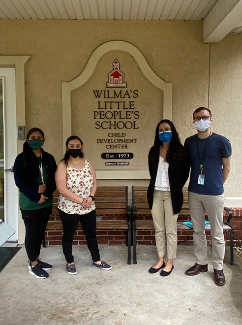 Speech-language pathology students standing in front of Wilma's Little People School on the campus of Jacksonville University.
