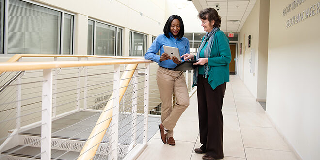 Photo of two hospital administrators talking