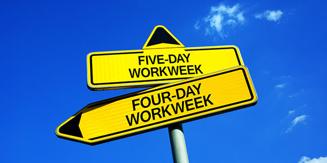 Two road signs. One points to a five-day workweek and the other to a four-day workweek.