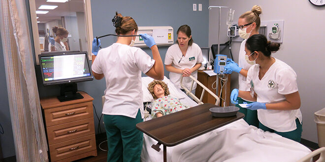 """Students tending to a """"patient"""""""