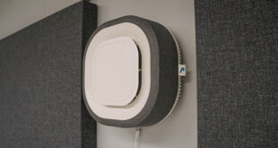 Photo of Aura Air Filter on a Wall in a classroom on campus