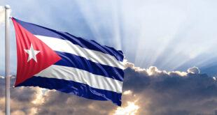 The flag of Cuba set against the sky